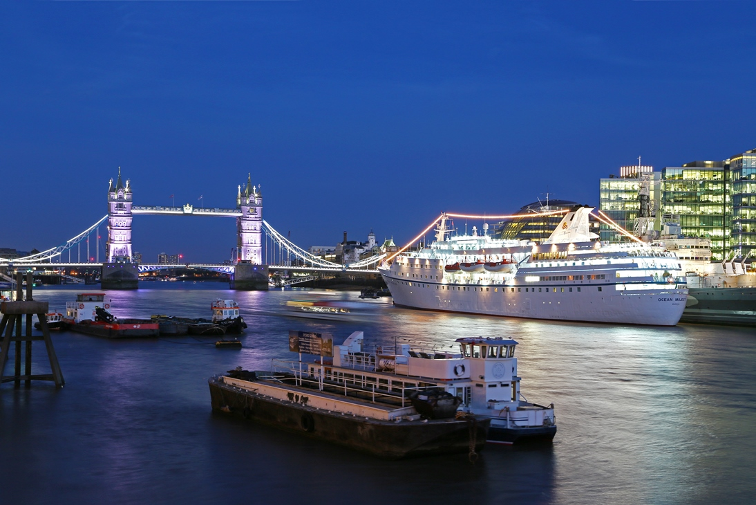 ms_ocean_majesty_and_tower_bridge_at_ dusk