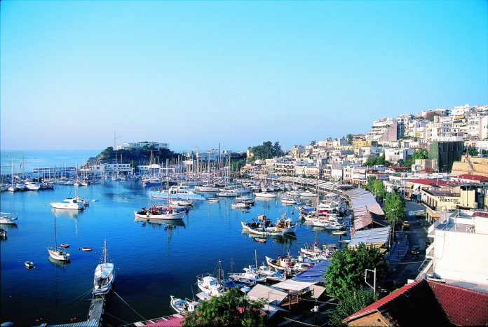 Boats in the yacht harbour and the town of Piraeus in the background, near Athens, Greece, Europe
